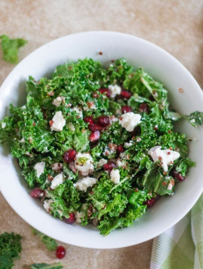 kale and quinoa salad with pomegranates goat cheese and and a delicious champagne dressing