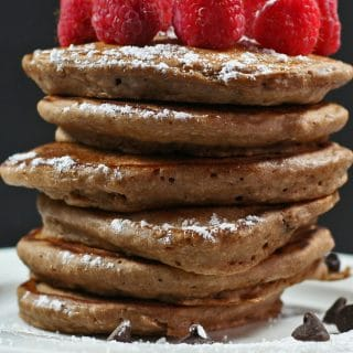 fluffy double chocolate pancakes topped with raspberries