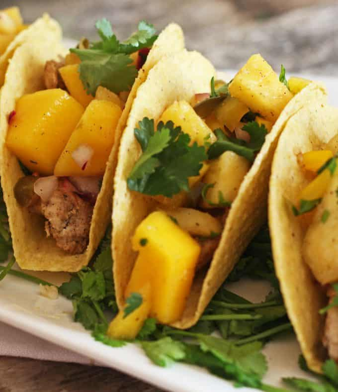 easy chicken tacos with pineapple mango salsa cover