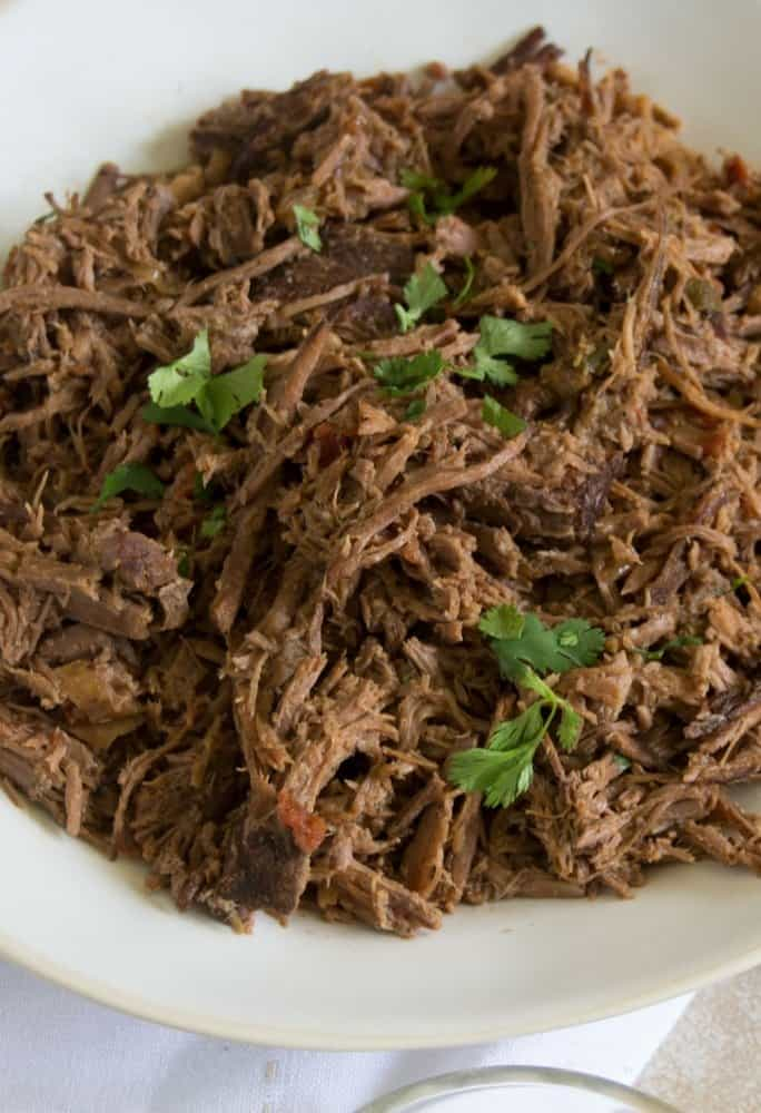 Shredded beef with Mexican seasonings on a platter
