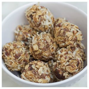 no bake coconut and date energy bites sitting in a white bowl.