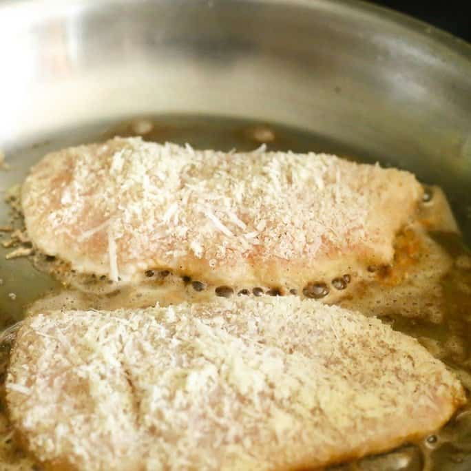 low carb lemon chicken breasts sauteed in made with almond flour, white wine, shallots and capers.