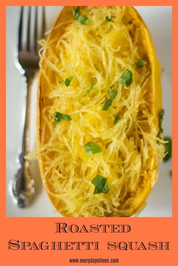 An aerial view of healthy roasted spaghetti squash with a sprinkling of fresh basil.