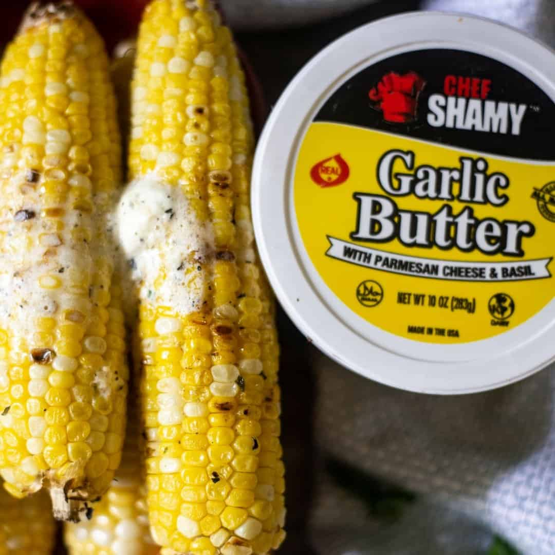 BBQ corn on the cob that has been grilled and smeared with Chef Shamy Garlic Butter