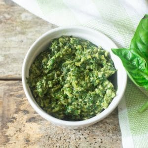 The most delicious homemade skinny basil pesto ready to be added to a great bowl of pasta