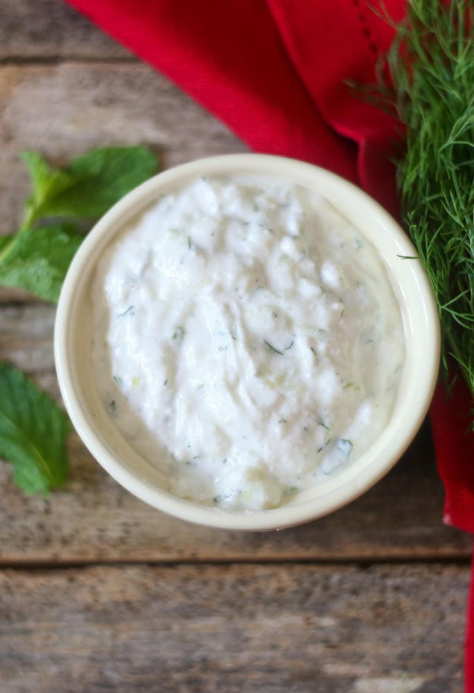 Greek Tzatziki Sauce in a white bowl ready to be served with grilled veggies or Gyros