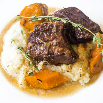 Instant pot guinness braised beef with carrots with mashed cauliflower and herbs