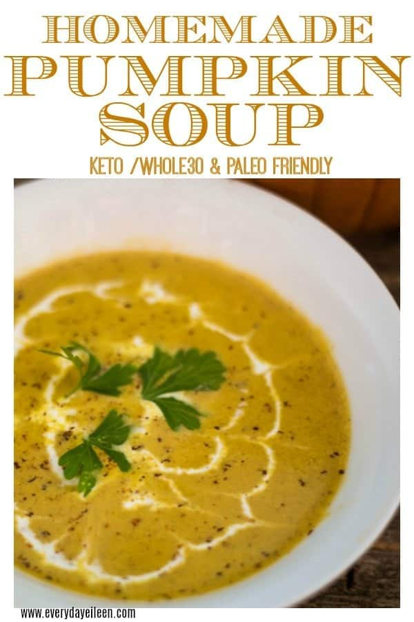 A Delicious pumpkin soup recipe in a white bowl with fresh nutmeg, creme fraiche, and parsley in the center of the soup.