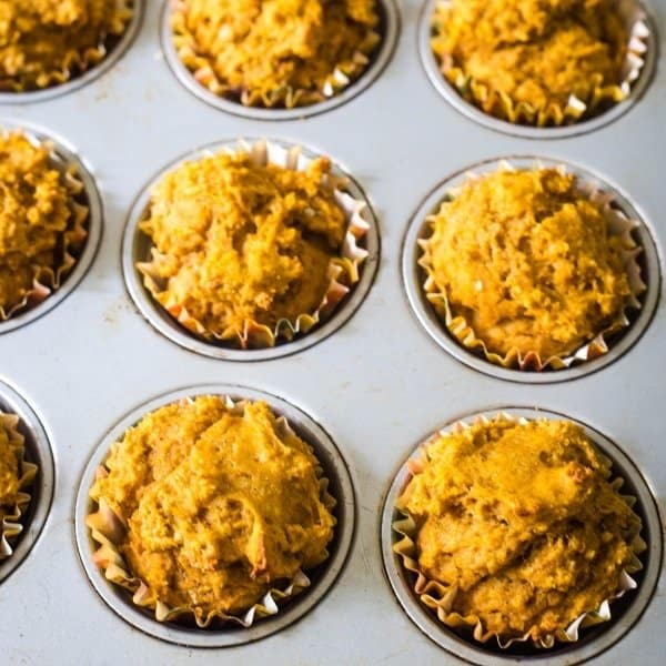 Baked healthy pumpkin muffins in a muffin tin