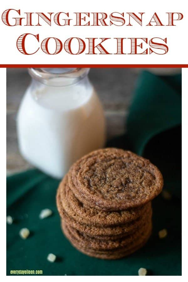 Gingersnap cookies and milk on a green linen