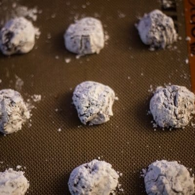 Chocolate crinkle cookie dough on a Silpat ready to be baked.
