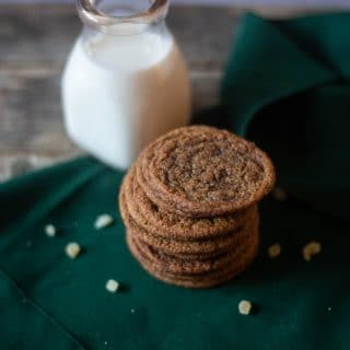 Gingersnap cookies with a jug of milk ready to be served for some Holiday treats!