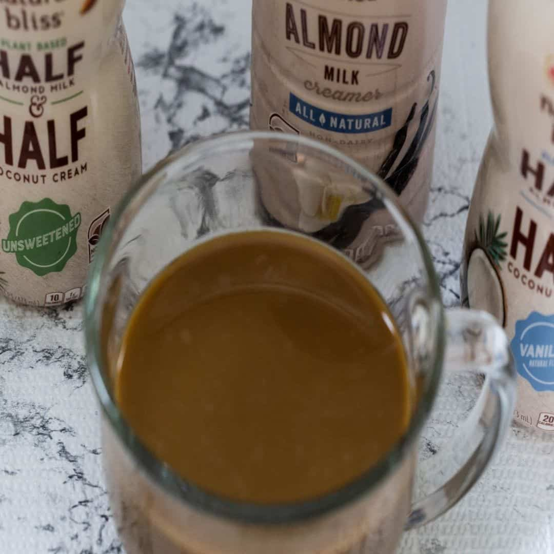 Coffee in a clear mug with Coffee mate® natural bliss® Plant Based Half & Half Unsweetened Coffee mate® natural bliss® Plant Based Half & Half Vanilla 16oz