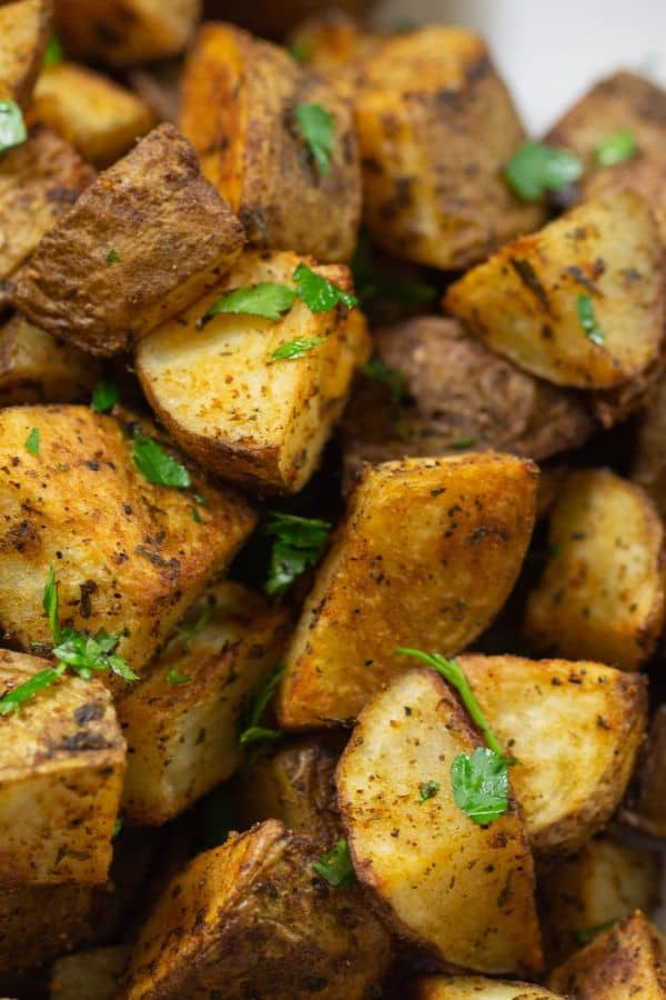 Crispy Roasted potatoes seasoned with spices and fresh parsley.