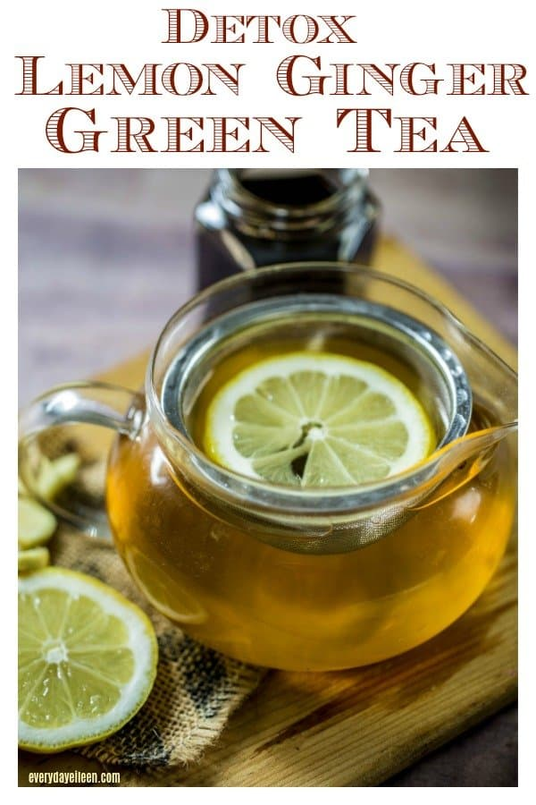 ginger green tea in a glass teapot with lemon in the pot.