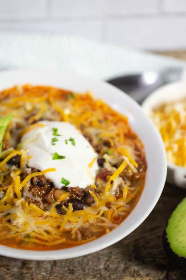 Delicious and hearty chipotle chili topped with sour cream, Mexican cheese, and chopped cilantro.