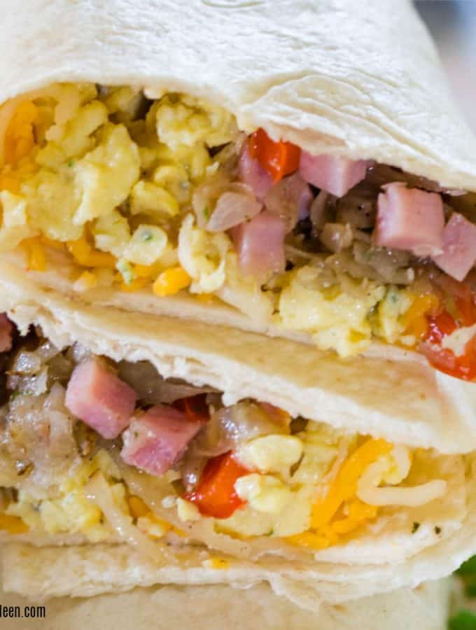 Tasty breakfast burritos made with ham and cheese ready stacked and ready to be eaten.
