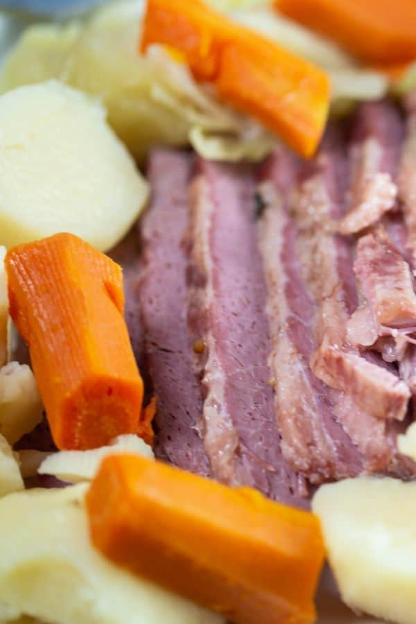 Delicious corned beef, cabbage, carrots, and potatoes that have been slow cooked!