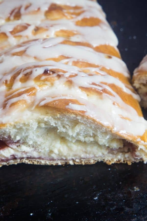 Cream cheese danish sliced open on a sheet pan.