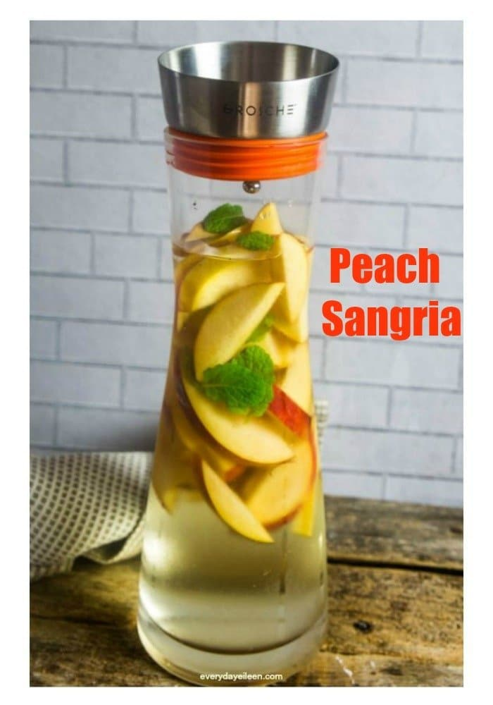 Refreshing Peach Sangria in a Grosche Sangria Pitcher! A sweet sangria that is perfect for your Easter or  Mother's Day brunch! #ad #EasterBrunchWeek #everycupfillsanother  via @everydayeileen
