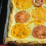 Cooked puff pastry topped with ricotta cheese and fresh tomatoes