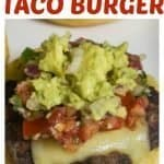 Delicious taco burger on a bun topped with pepper jack cheese, pico de gallo, and guacamole