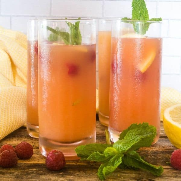 refreshing summer punch in glasses garnished with mint and fresh fruit