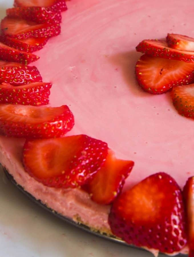 strawberry cheesecake topped with fresh strawberries