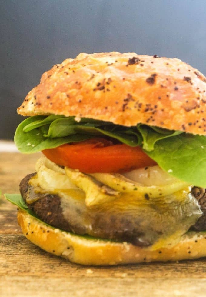 grilled portobello mushroom topped with caramelized onion, tomatoes and gouda cheese o