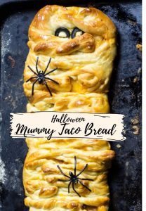 A mummy taco bread on aa baking tray ready to be served for a Halloween treat.