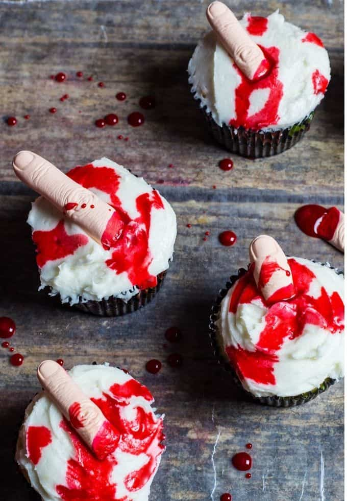A few vanilla cupcakes with edible fingers covered with edible blood