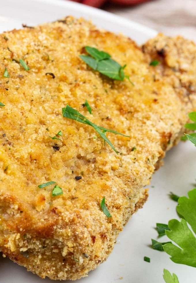 Boneless pork chop cooked with a crispy bread crumb coating.