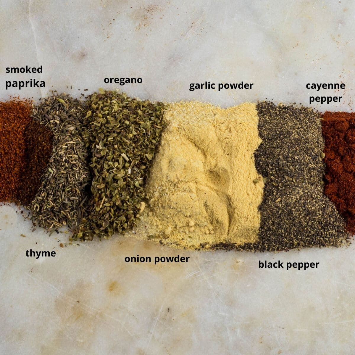 spices on a slab of marble to make cajun seasoning/