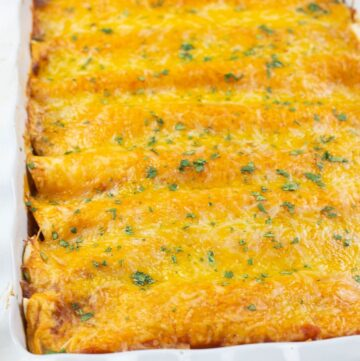 A casserole of beef enchiladas covered with melted cheese