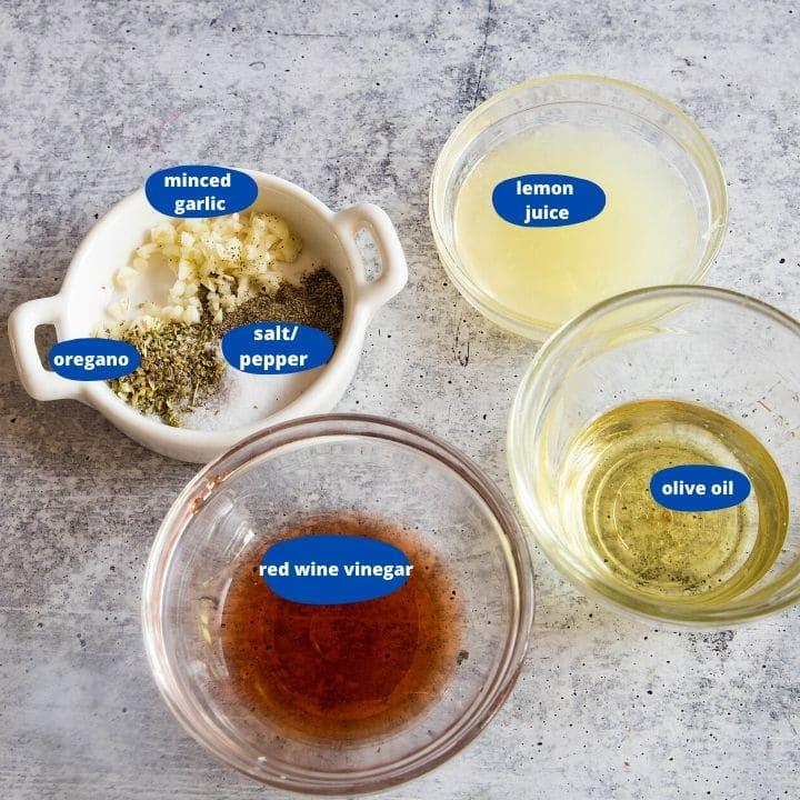 Ingredients to make Greek Vinaigrette, lemon juice, red wine vinegar, lemon juice, minced garlic, oregano, salt, and black pepper for a pasta salad
