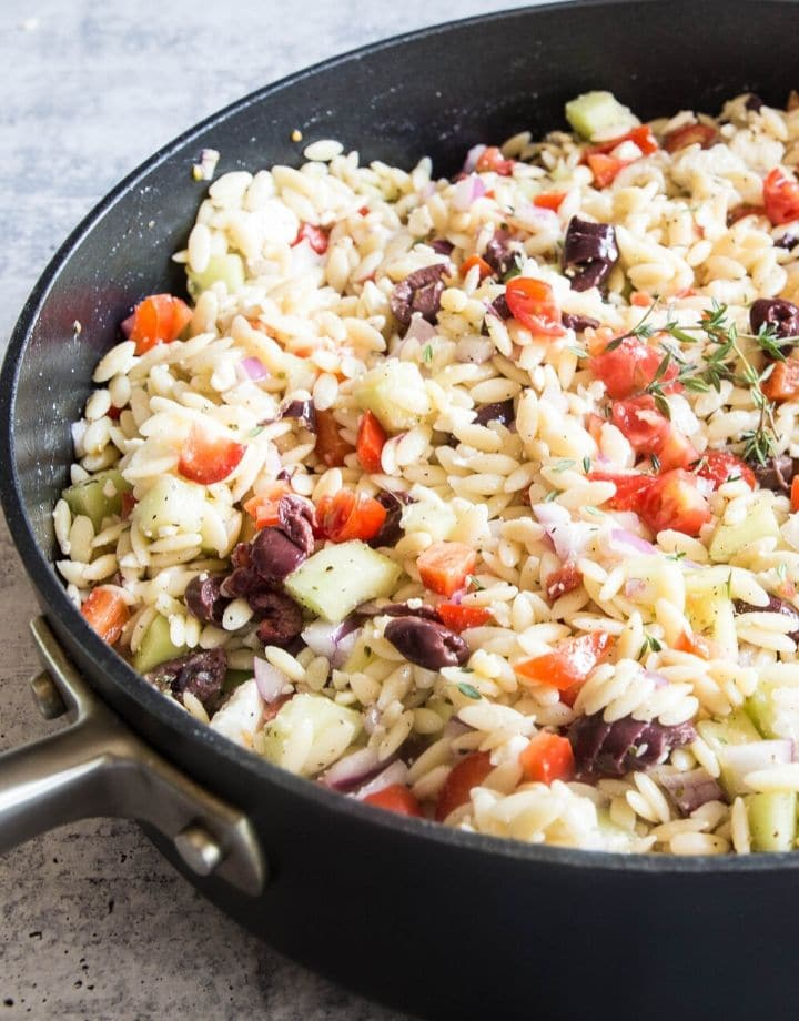 An orzo salad filled with olives,cucumbers,tomatoes and topped with a vinaigrette.