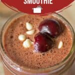 A pinterest pin of cherry chocolate smoothie in a mason jar.