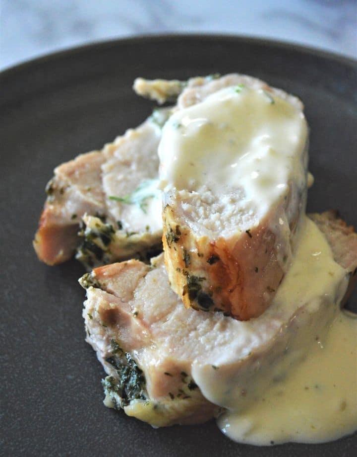 Sliced roasted pork loin topped with an herb lemon sauce.