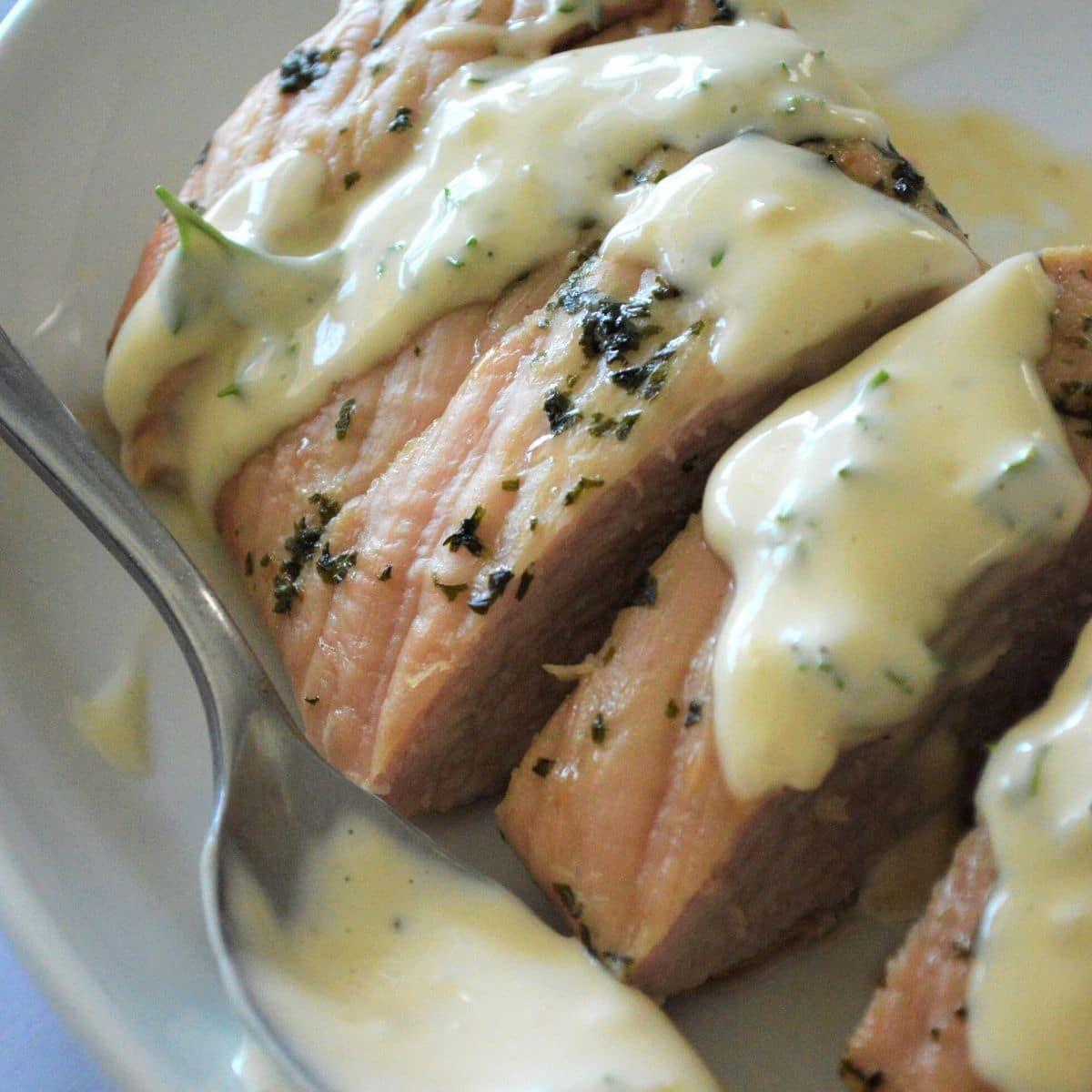 sliced roast pork with a lemon herb sauce