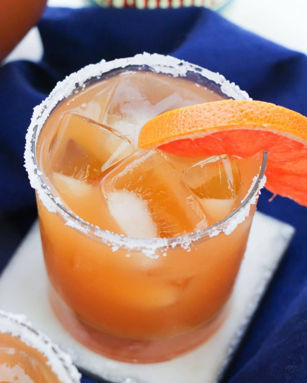 An overhead view of a grapefruit margarita in a glass