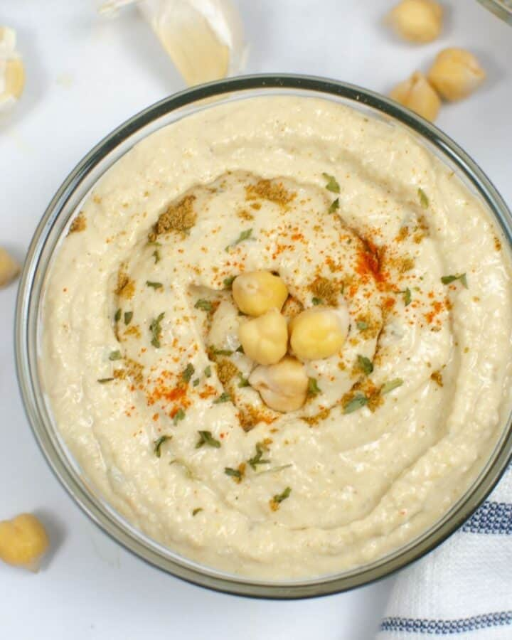 an overhead view of chickpea hummus in a bowl