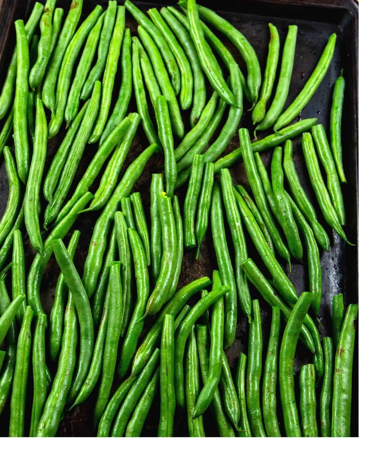 Fresh green beans on a baking sheet