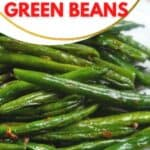 A platter of green beans with roasted garlic