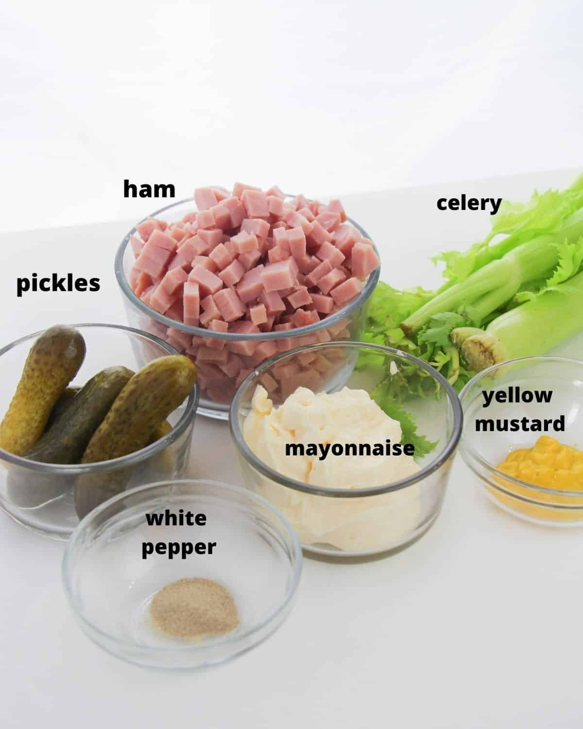 The ingredients needed to make ham salad in bowls.