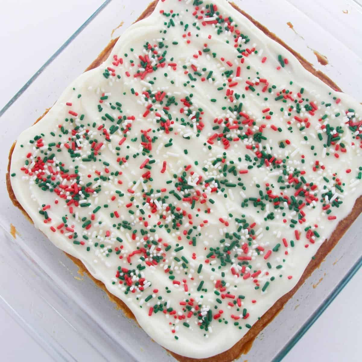A finished sugar cookie cake topped with red, green, and white sprinkles.