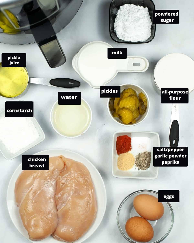 Chicken cutlets, eggs, milk, powdered sugar, milk, flour, water, pickles, and an air fryer to make chicken sandwiches