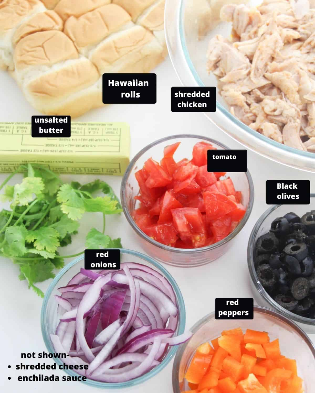 The ingredients to make chicken sliders on a white table.