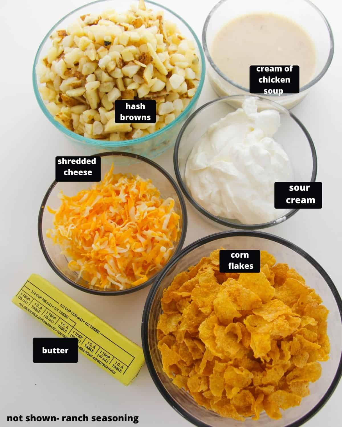 Ingredients hash browns, cream of chicken soup, cheese, corned flakes, sour cream, and butter.