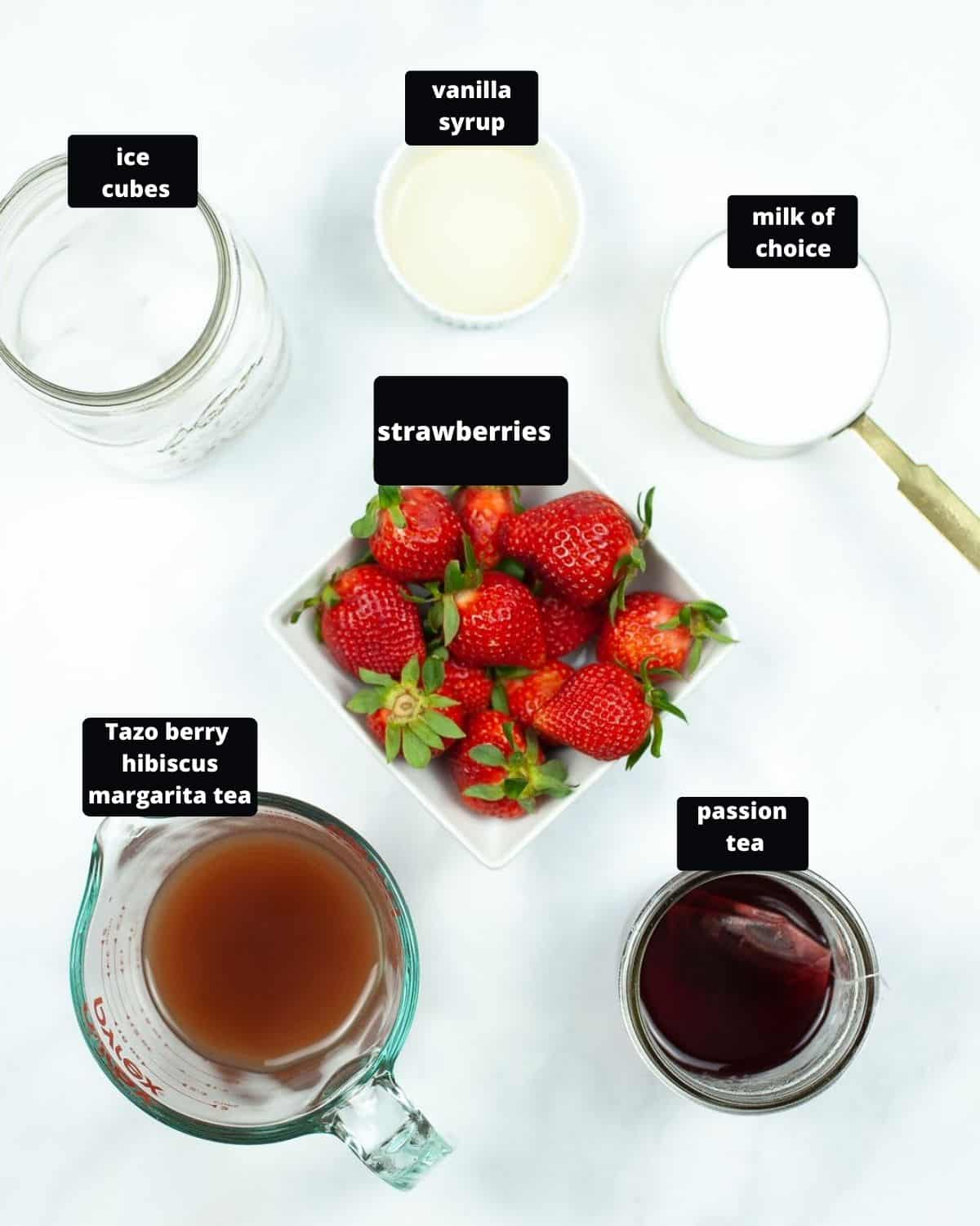 The ingredients to create a pink drink, copycat Starbucks drink on a white table.