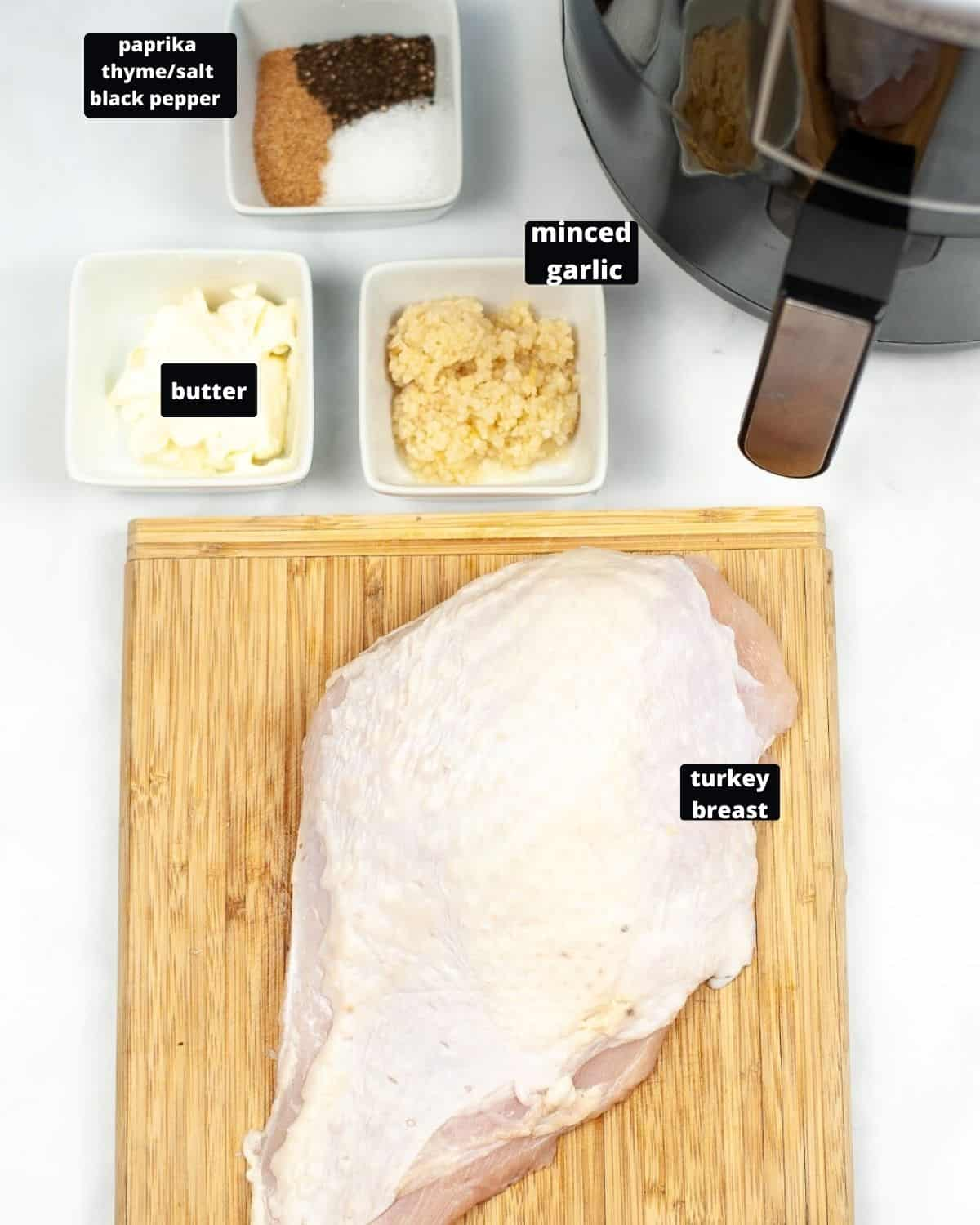 Ingredients to make air fryer turkey on a white surface.